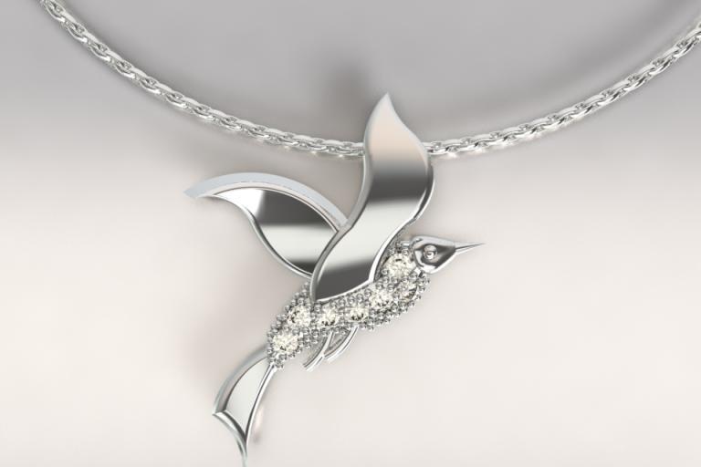 pendentif cayouckette or blanc 750/1000 poids 5.20gr et diamants 0.10ct  h/si