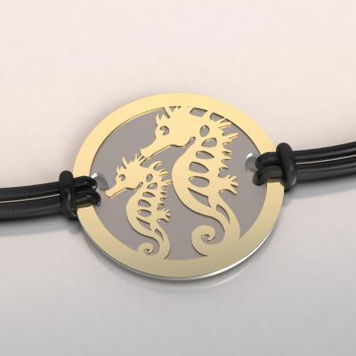 bracelet or et acier hippocampe et son petit